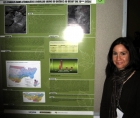 Photo of Édith Bégin at a conference, next to a poster presenting her research